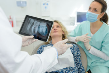 patient being shown digital x-ray