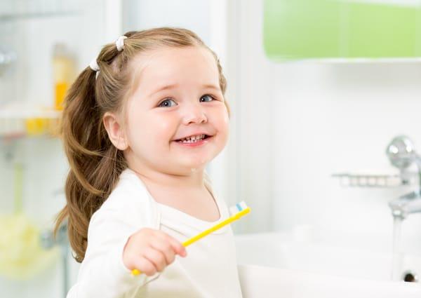 child brushing her baby teeth