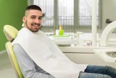 man smiling after treatment of gum disease