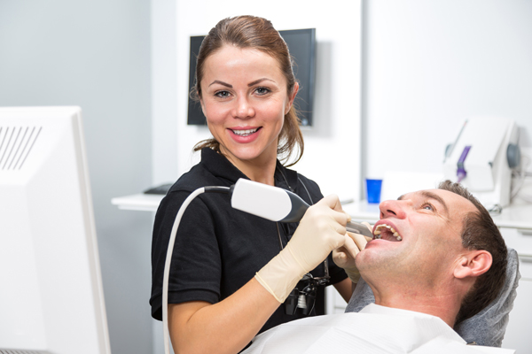 dentist performing restorative dentistry