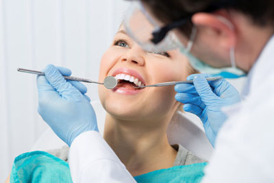 girl at dentist getting tooth extraction